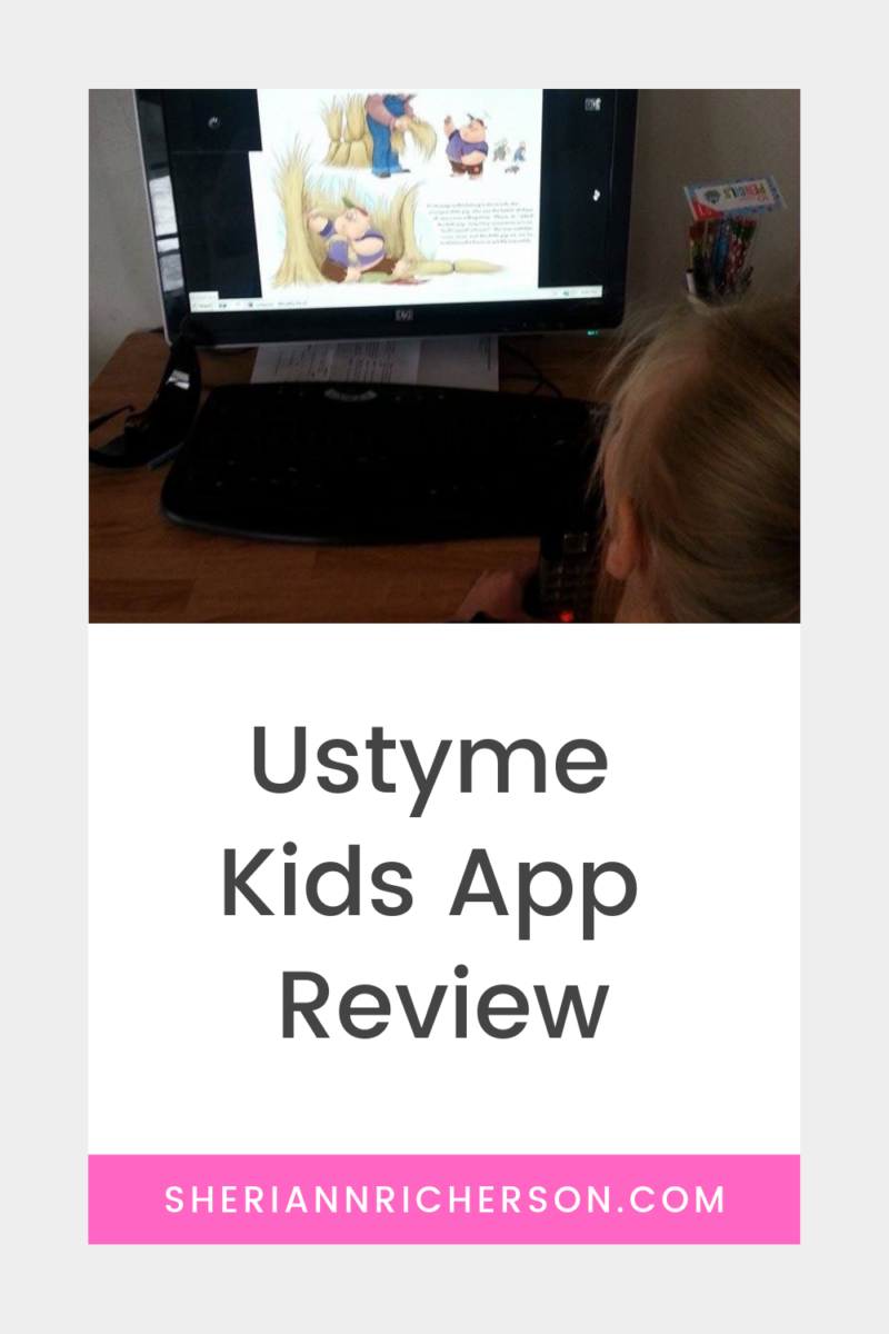 My grand daughter sitting at a computer while I read Three Little Pigs using the Ustyme Kids App.